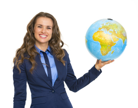 Smiling business woman holding earth globe photo
