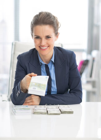 money packs: Happy business woman giving money packs Stock Photo
