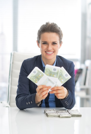 money packs: Smiling business woman showing money packs