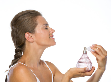 Young woman applying perfume photo