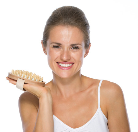 massager: Happy young woman with massager Stock Photo