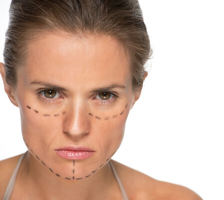 disquieted: Portrait of concerned young woman with plastic surgery marks Stock Photo