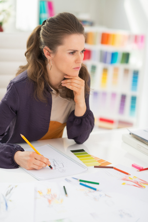 disquieted: Portrait of concerned fashion designer in office Stock Photo