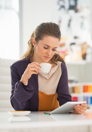 Fashion designer using tablet pc at work photo
