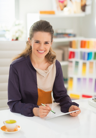 Fashion designer working on tablet pc in office photo