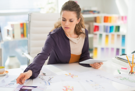 Fashion designer working in office Stock Photo - 27226006