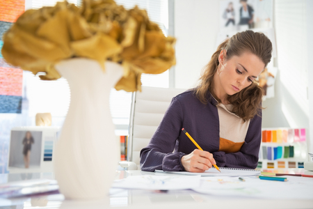 Fashion designer working in office Stock Photo - 27221500