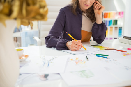 Closeup on fashion designer making sketches in office Stock Photo - 27221499