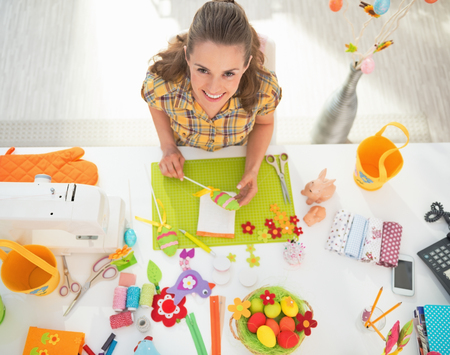 Young woman making easter decoration Stock Photo - 27518686