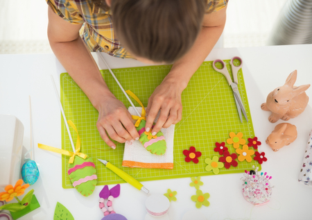 Closeup on young woman making easter decoration Stock Photo - 27518687