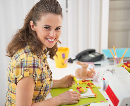 Happy young woman making easter decoration Stock Photo - 27518691