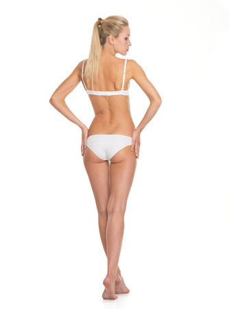 white underwear: Full length portrait of young woman in lingerie. rear view