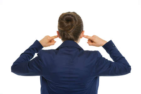 Business woman closing ears. rear view Stock Photo