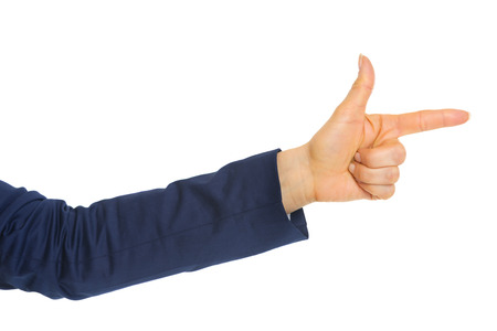 Closeup on business woman pointing with finger gun Stock Photo - 28062589