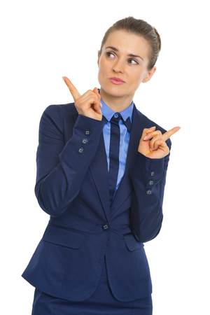 clueless: Portrait of clueless business woman pointing Stock Photo
