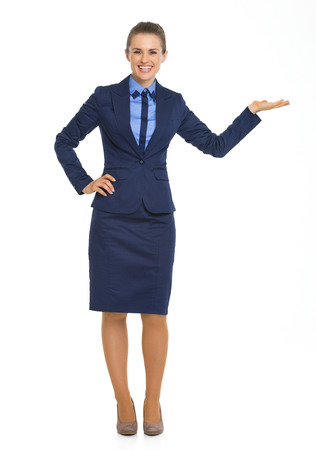 Full length portrait of business woman presenting something on empty palm