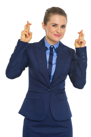 Portrait of business woman with crossed fingers photo