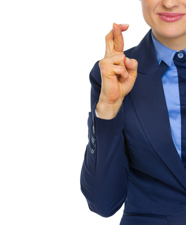 crossed fingers: Closeup on business woman with crossed fingers
