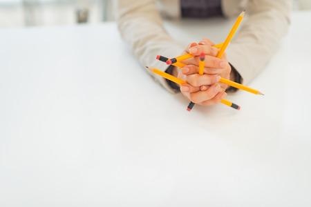 disarrangement: Closeup on business woman holding pencils Stock Photo