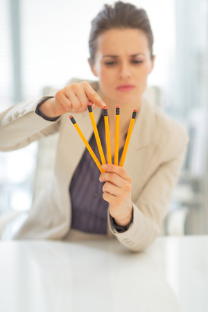incorporation: Closeup on business woman pointing on pencils