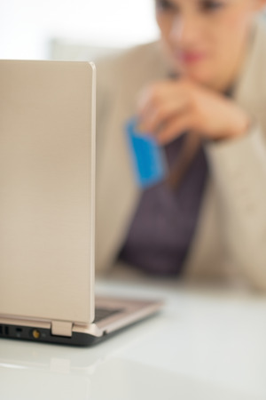 topicality: Closeup on business woman credit card using laptop Stock Photo