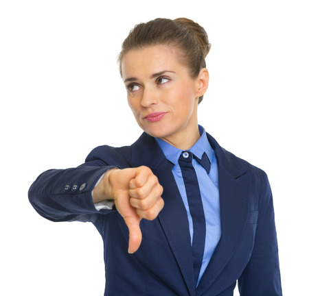 Displeased business woman showing thumbs down photo
