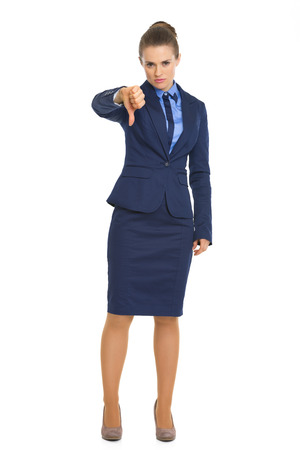 Full length portrait of business woman showing thumbs down photo