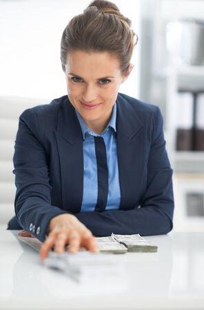 money packs: Business woman giving money packs