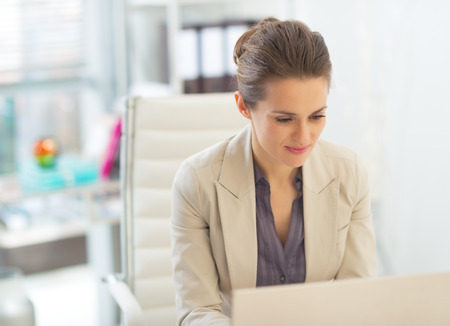 Business woman working on laptop Stock Photo - 28131394