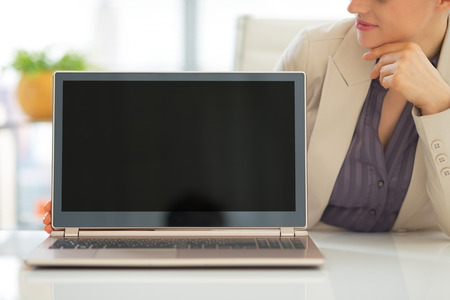 topicality: Closeup on business woman showing laptop blank screen Stock Photo