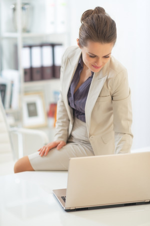 topicality: Business woman working on laptop in office