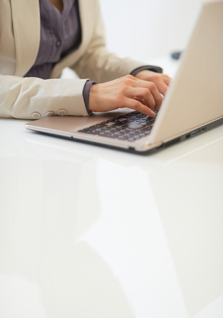 topicality: Closeup on business woman working on laptop
