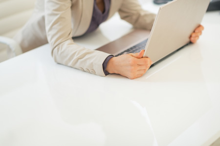 topicality: Closeup on business woman holding laptop