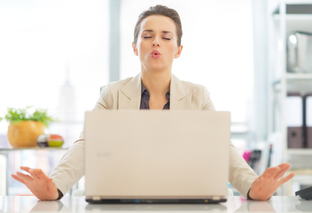 work: Business woman with laptop relaxing