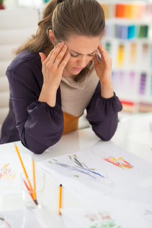 Portrait of stressed fashion designer in office Stock Photo - 28357732