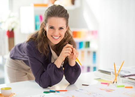 Portrait of smiling fashion designer in office Stock Photo