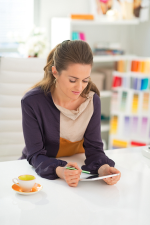Fashion designer working on tablet pc Stock Photo - 28357818