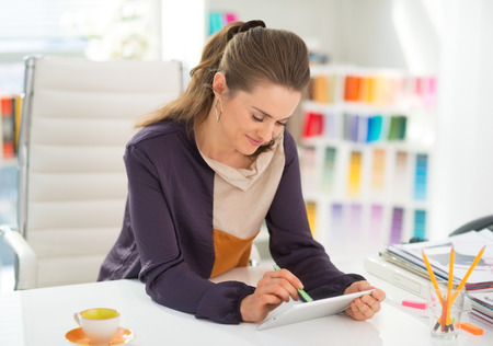 Fashion designer working on tablet pc in office Stock Photo - 28357820