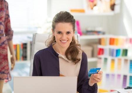 Fashion designer using laptop with credit card Stock Photo - 28357832
