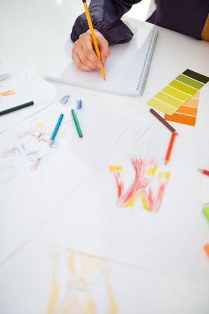 Closeup on fashion designer making sketches Stock Photo - 28357834