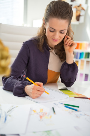 Fashion designer making sketches in office Stock Photo - 28357837