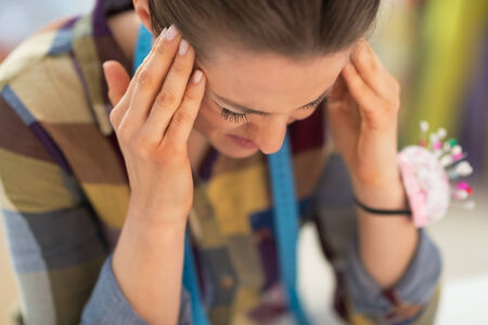 worried woman: Portrait of stressed seamstress Stock Photo
