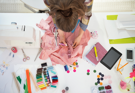 work clothes: Seamstress working in studio