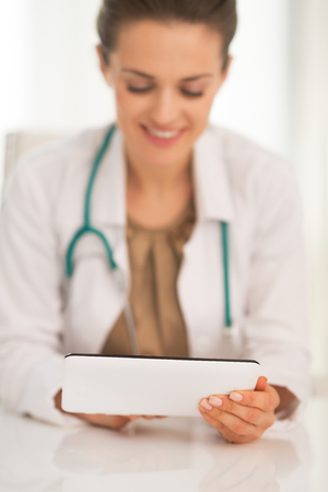 Closeup on happy medical doctor woman using tablet pc Stock Photo - 28769190