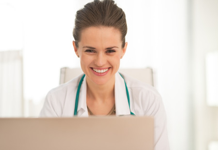 Portrait of smiling medical doctor woman using laptop Stock Photo - 28769232