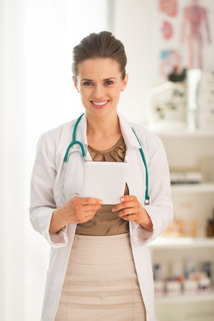 topicality: Portrait of happy medical doctor woman with tablet pc