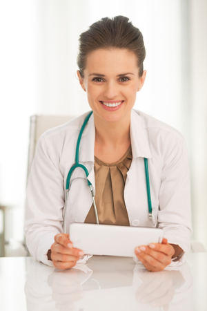 topicality: Portrait of happy medical doctor woman using tablet pc Stock Photo