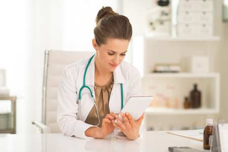 topicality: Medical doctor woman using tablet pc