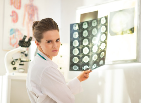 Portrait of medical doctor woman with tomography photo