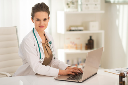topicality: Medical doctor woman working on laptop